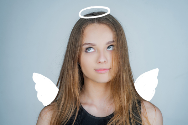 Child with cartoon angel wings and halo