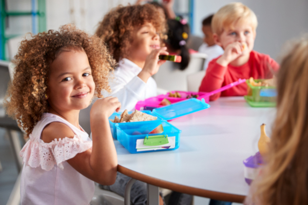 Children eating packed lunches at school