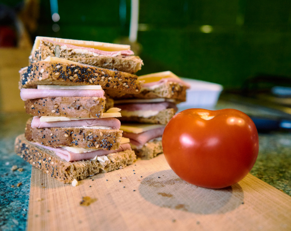 Sandwich With Cheese And Ham On Cutting Board