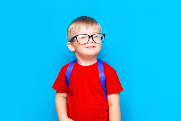 Happy Smiling Boy In Red T-shirt In Glasses Is Going To School