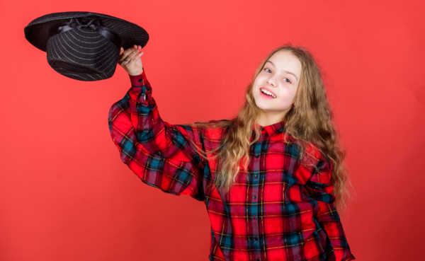 Girl performing with a hat, practicing acting
