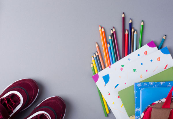 Sports Shoes With A Backpack, Books, Pencils, On The Background.
