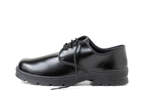 Black school shoe on white background