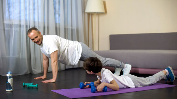 Family doing the plank and exercise at home