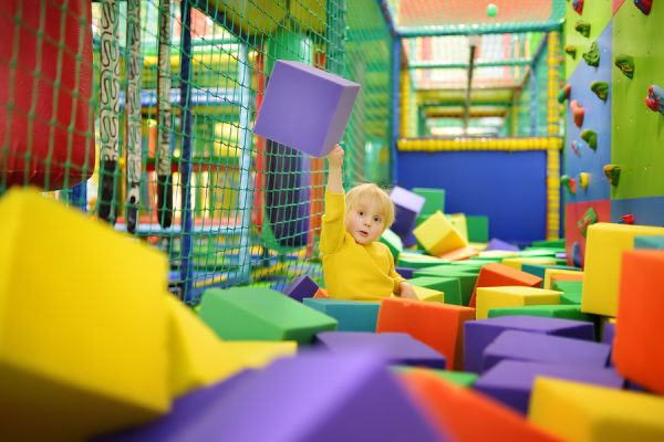 Young boy playing in soft play centre