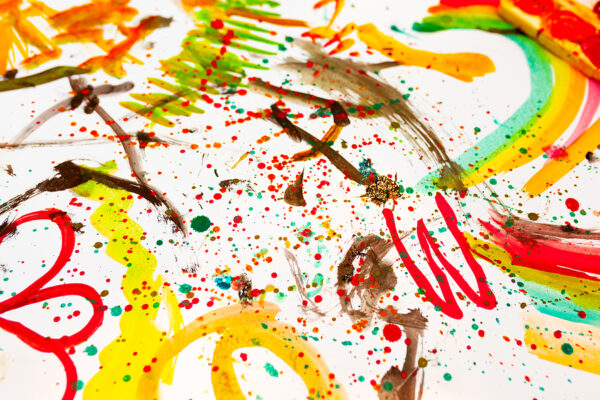 drawing in colorful colors. Close, top view. Children entertainment, family leisure. Scribble painting