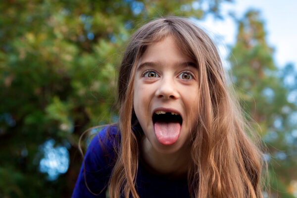 A young girl makes a funny face for the camera.