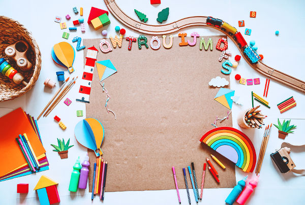 Colourful craft supplies and toys on a table