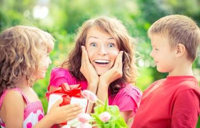 Children giving mum flowers