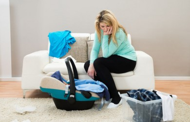 Unhappy mother with laundry