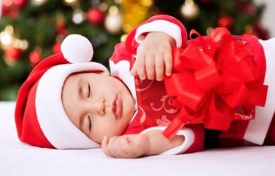 Toddler holding Christmas present
