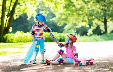 fearure child-helping-friend-fallen-off-skateboard