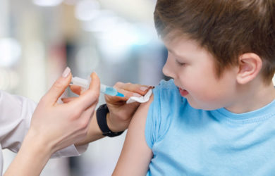 A Closeup Of A Teenage Child Receiving A Vaccine From A Pediatri