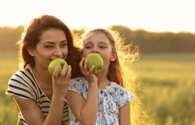 Happy Mum and daughter eating