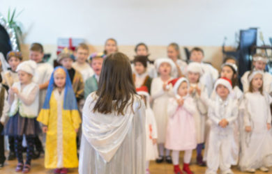 children perform at concert in primary school.