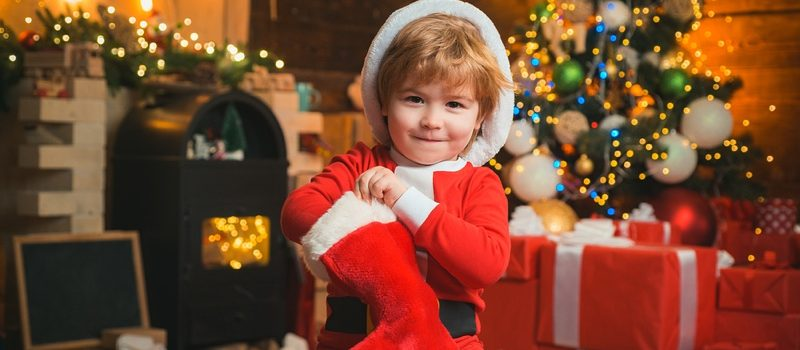 Child holding Christmas Stocking