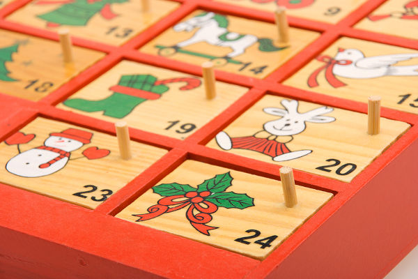 close-up view of a hand painted wooden advent calendar